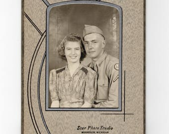 Soldier and his girl, vintage World War Two photo in folder