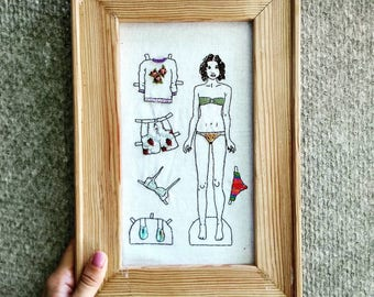 Embroidery, paper doll