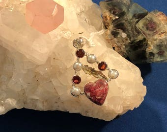 Heart shaped rhodochrocite, garnet and pearls
