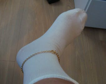 ankle chain filled gold with lock on made by britta larsen 25 cm long
