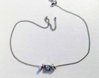 Thin chain (1.2 mm) silver - 40 cm + 5.5 cm with 1 sliding white Crystal Pearl surrounded by iridescent Crystal rondelles