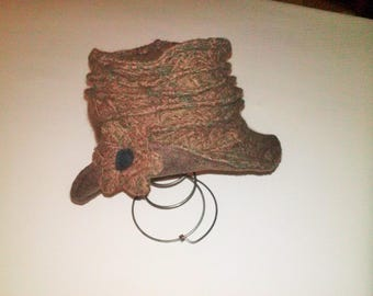 Brown wool-blend hat with a black flower.