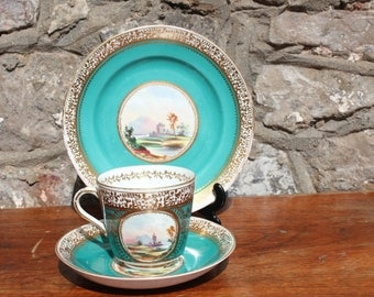 Antique Handpainted Trio Gilded and Painted with Ruins Scene Cup Saucer Side Plate