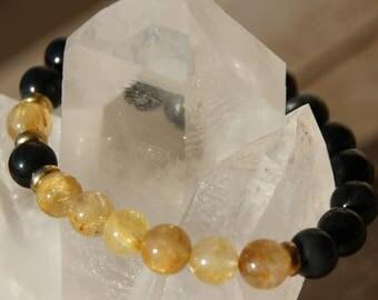 Obsidian and rutilated quartz bracelet