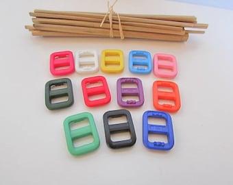 12 loops 2 x 1.5 cm plastic 11 colors for strap 1 cm - ref 2.56