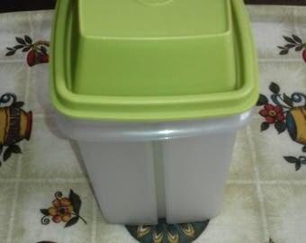 Vintage green Tupperware pot has pickles