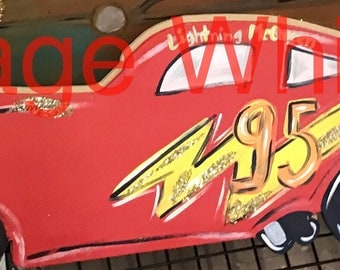 "26 W x 8"" H finished Lightning McQueen inspired cutout"