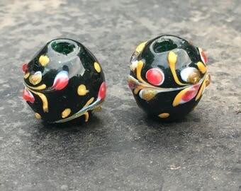Pair of fancy antique Venetian fancy beads, floral design on deep green