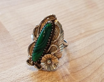 Green Malachite and Sterling Silver Ring Size 6. Leaf and flower details around the side of the stone.