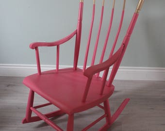 Rose pink and gold rocking chair