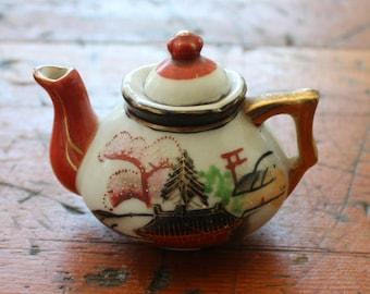 Vintage miniature hand painted teapot