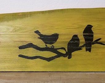 "Birds on branch silhouetter, daisy on pine board, 24"" x 5 3/4"" x 1/2"""