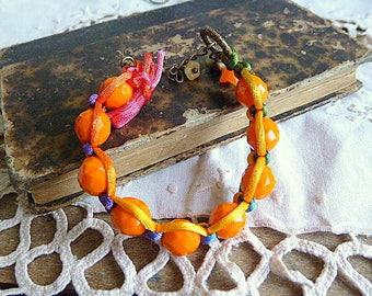 Orange faceted as a shamballa bracelet
