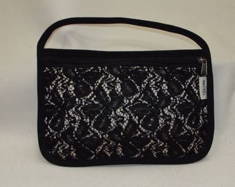 Black clutch with black and white lace pattern