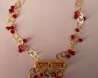 gold plated necklace and earrings