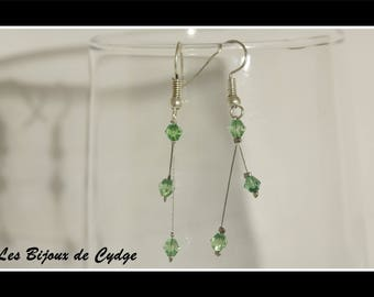 Earrings on twisted wire and its dark green bicone bead