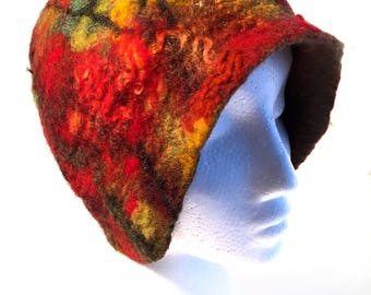 Hand felted designer women's wool hat. Fall leaf design of orange, red, yellow