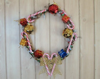 """Pre-Lit Wacky Christmas Wreath / 12"""" / LED Lights / Batteries Included / Ribbons / Candy Canes / Ornaments / Presents / Bow / Snowflakes"""