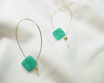 Handmade light-weight earrings with green synthetic stones.