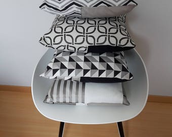 Black and grey geometric patterned pillow cover light for a chic modern style