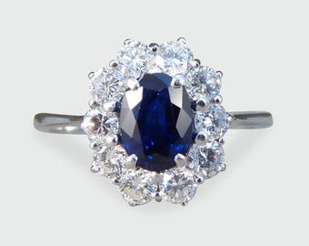 Sapphire and Diamond Cluster Engagement Ring in 18ct White Gold