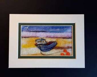 Original felt picture of a boat on the beach