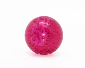 Pink bubble glass paperweight