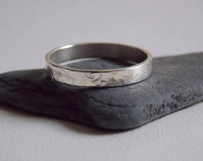 silver fine hammered ring.