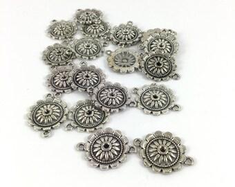 Antique set of 20 Silver Flower connectors