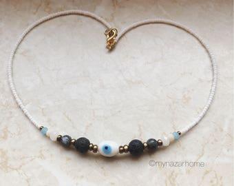 evil eye bead white, lava stone, crystal beads in white