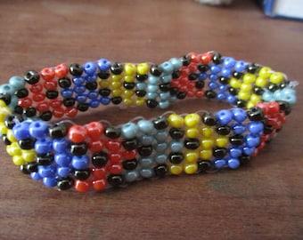 Diagonal stripe black, blue, red, green, yellow, bracelet