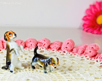 Small beagle and collie porcelain figurines