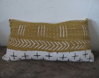 Handmade 15x25 lumbar pillow created with 2 colors of authentic African mud cloth