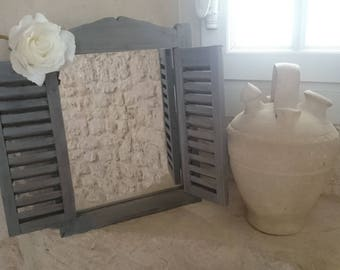 Louvered shutters and window mirror... Romantic and shabby