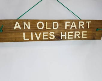 """Funny humorous rustic  handcrafted unquie arts craft  """"An old Fart lives here"""" wall hanging, hall, porch way, shed man lady cave garage gift"""