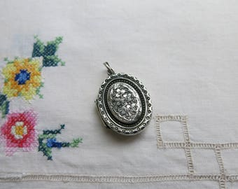 Victorian sterling silver locket, has been well-loved!