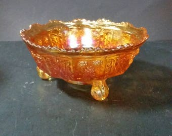 Vintage carnival glass 3 footed candy dish. Butterfly and berry pattern. Sawtooth edge.