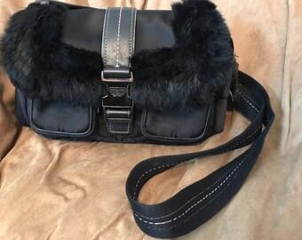 Fur trimmed Coach shoulder bag