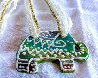 Hand sculpted clay elephant pendant