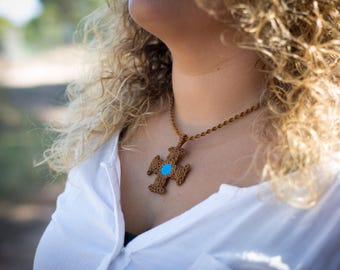 Macrame cross with turquoise