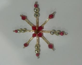 Eight-pointed star for the Christmas tree. Ornament in golden-red tones. Winter festive decor. Handmade.