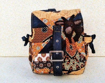 "Bag back, ""Making goat"", ""a biquette trip between Occitan and African province"" jean, wax, cotton... Size medium"
