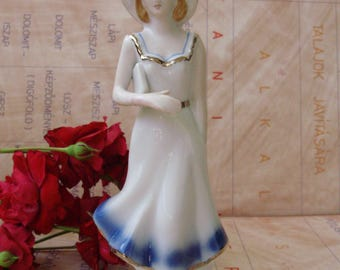 Vintage ,porcelain girl figurine ,stamped,handpainted