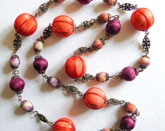 Long necklace, fabric beads, orange and plum organza