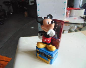 Mickey Mouse  by Disney cheerfully studying Mathematics trinket box with apple for his teacher