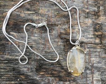 Rutile / rutilated quartz pendant necklace on snake chain