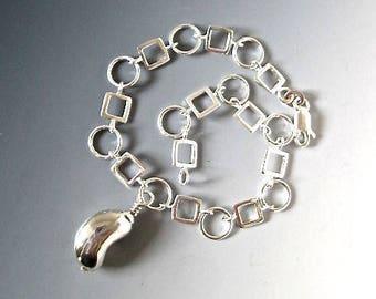 Sterling Silver Kidney Shaped Charm Bracelet-Geometric Design