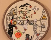 Trick or Treat? Hallows eve artwork, intricately hand embroidered, highly detailed, witch and skeleton, ghosts, pumpkin and black cat, cute