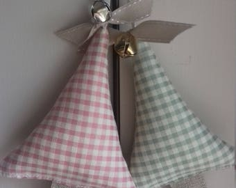 Stuffed Christmas trees in pastel check with ribbon and bell.  Christmas tree decoration.  Hanging decoration.  Scandi style. Shabby chic.