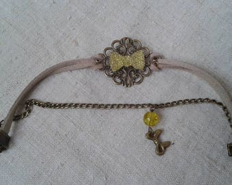 print and yellow rhinestone bow bracelet